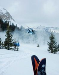A helicopter lands to pick up some backcountry skiers in Telluride's San Juan mountain range